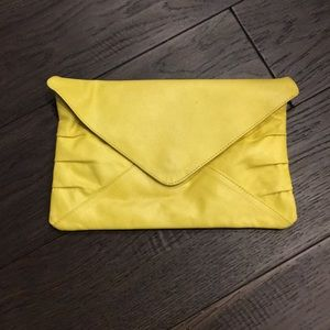 Vintage yellow leather clutch from UO